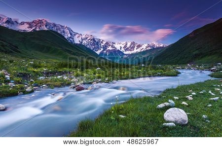 River in mountain valley at the foot of  Mt. Shkhara. Upper Svaneti, Georgia, Europe. Caucasus mountains. Beauty world.