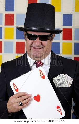 Middle aged repulsive businessman is showing ace of heart.