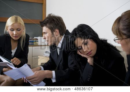 Businessman and businesswomen having a meeting.