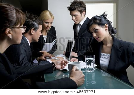 Businessmen and businesswomen having a meeting.