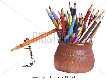 The Little Man From A Wire Drags A Colour Wooden Pencil