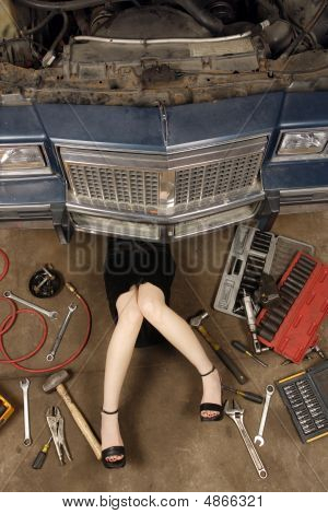Female Mechanic Fixing Stuff