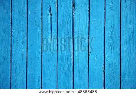 old wooden wall, blue background