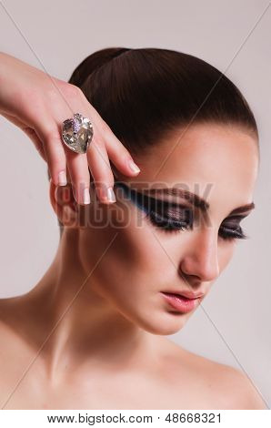 Fashion woman with jewelry ring. Fashion portrait