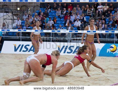 12/08/2011 LONDON, ENGLAND, Shauna Mullin & Zara Dampney (GBR) vs Alejandra Simon & Andrea Garci�?�a Gonzalo (ESP) during the FIVB Beach Volleyball, at Horse Guards Parade, Westminster, London.