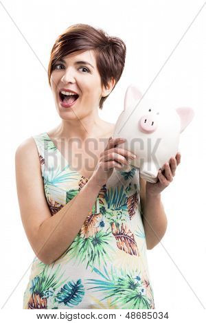 Admired woman with a piggy bank, isolated over a white background