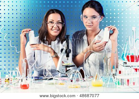 Laboratory staff demonstrating drugs. Laboratory equipment.