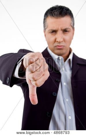 Front View Of Unhappy Boss Showing Thumb Down