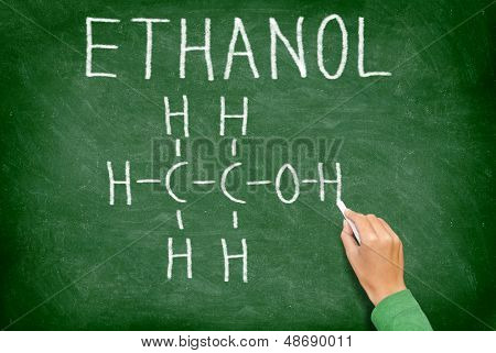 Ethanol alcohol chemical molecule structure on chalkboard. Science teacher or chemistry student drawing chemical formula on blackboard in class.