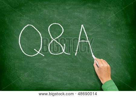 Q and A - Questions and Answers concept blackboard. Question and answer, support and help concept chalkboard concept with hand writing.
