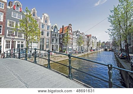 Medieval houses along the canal in Amsterdam Netherlands