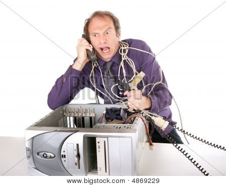 Businessman Fighting With Technology