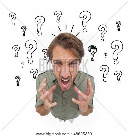 Irritated man gesturing and yelling with question marks on the background