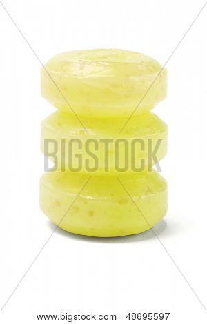 Stack Of Three Yellow Lozenges On White Background