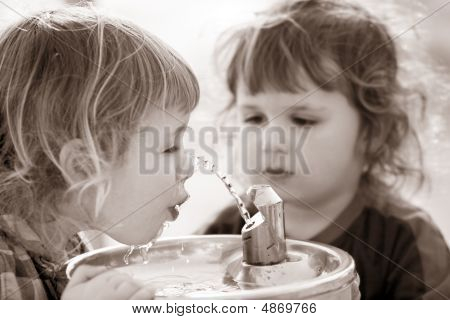Two Boys By The Drinking Fountain