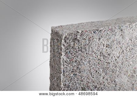 Cellulose insulation batt panel, made of recycled newspapers, used as building thermal insulation.
