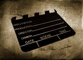 stock photo of crew cut  - cinema clapboard used by directors over vintage background - JPG