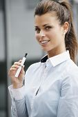 stock photo of e-cigarettes  - portrait of young female smoker smoking e - JPG