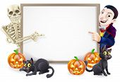 stock photo of skeleton  - Halloween sign or banner with orange Halloween pumpkins and black witch - JPG