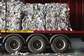 image of lorries  - Stacks of recycled papers on lorry in recycling plant - JPG