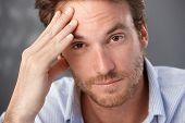 stock photo of frown  - Closeup portrait of troubled man looking at camera - JPG