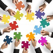 image of joining hands  - Teamwork and integration concept with puzzle pieces - JPG