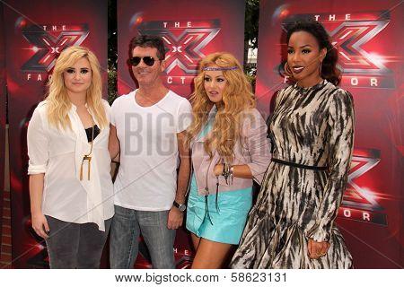 Demi Lovato, Simon Cowell, Paulina Rubio and Kelly Rowland at