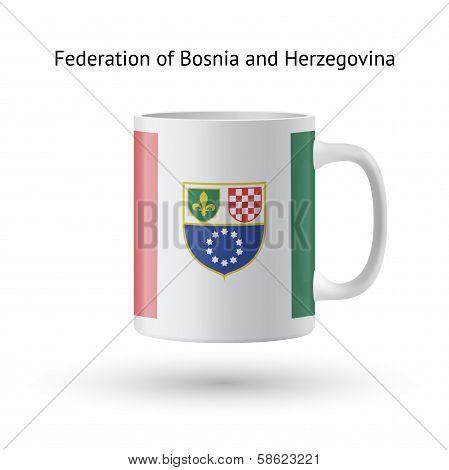 Federation of Bosnia and Herzegovina flag souvenir mug on white.