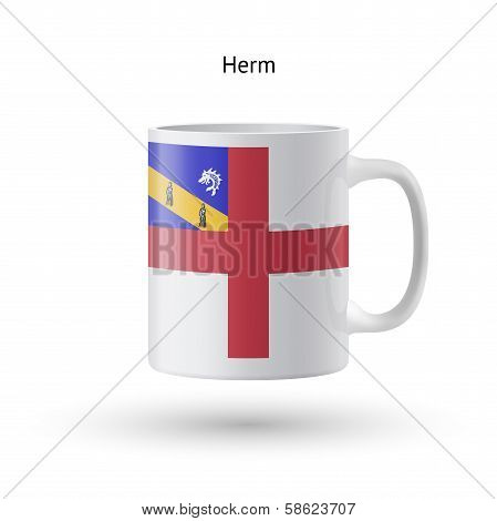 Herm flag souvenir mug on white background.