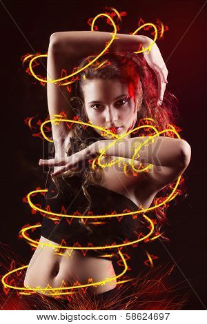 young girl dancing with fire
