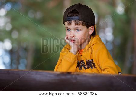 Portrait of a little boy having relax outdoors