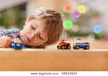 Little Blond Boy Playing With Cars And Toys At Home, Indoor.