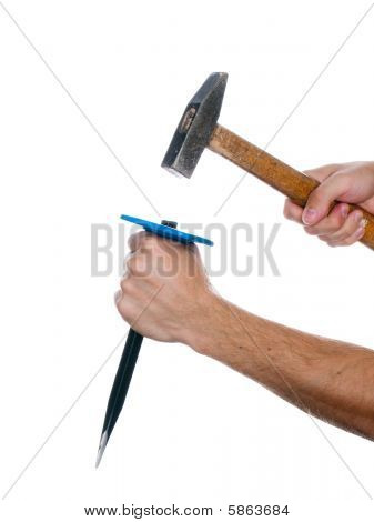 Chisel And Hammer In Hand