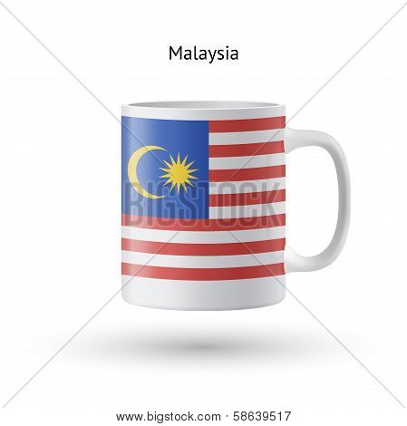 Malaysia flag souvenir mug on white background.