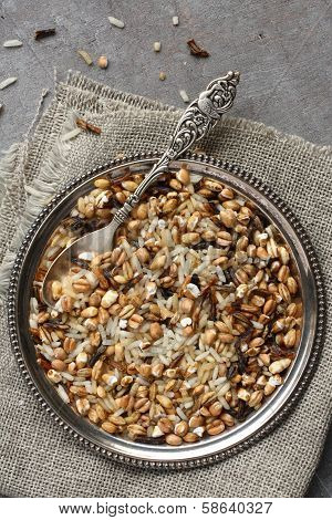 Uncooked Multigrain Rice In Metal Plate On Wooden Background