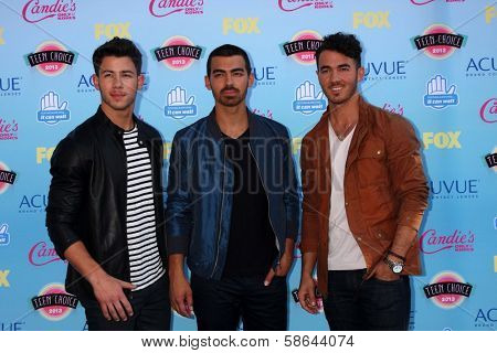 Nick Jonas, Joe Jonas, Kevin Jonas at the 2013 Teen Choice Awards Arrivals, Gibson Amphitheatre, Universal City, CA 08-11-13