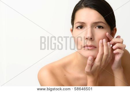 Beautiful Woman Checking Her Complexion