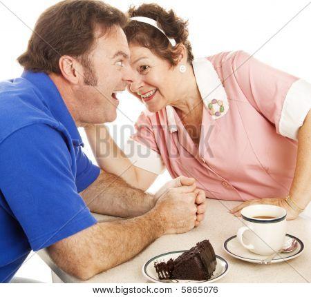 Waitress Gossips With Customer
