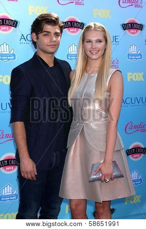 Garrett Clayton and Claudia Lee at the 2013 Teen Choice Awards Arrivals, Gibson Amphitheatre, Universal City, CA 08-11-13