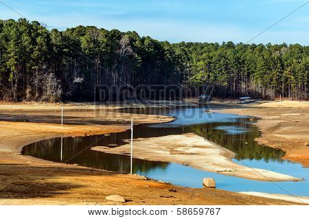 Dried up lake with docks sitting on ground