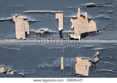 Peeling Gray Paint On A Wooden Wall