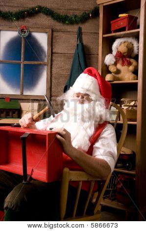 Santa Claus In Workshop With Wagon
