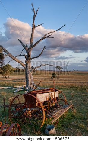Old Farm Machinery In Field