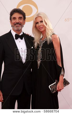 Chuck Lorre and guest at the 65th Annual Primetime Emmy Awards Arrivals, Nokia Theater, Los Angeles, CA 09-22-13