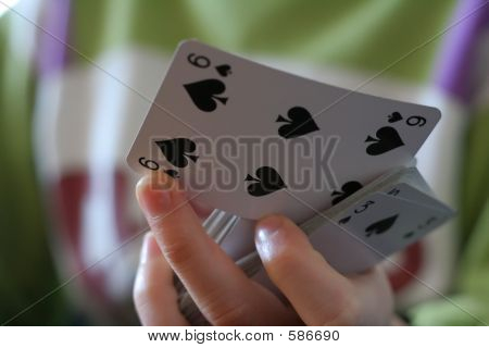 Six Of Spades Playcard In Hand