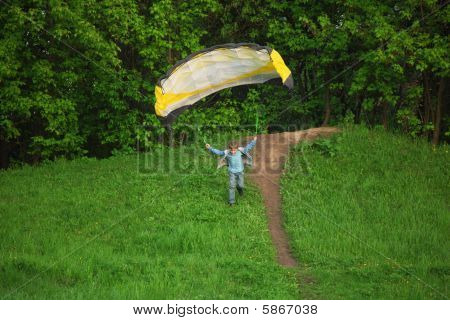 boy starts to fly using parachute