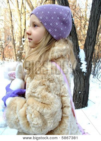 Girl in a warm fur clothing