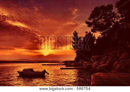 Boat With Sunset In Red