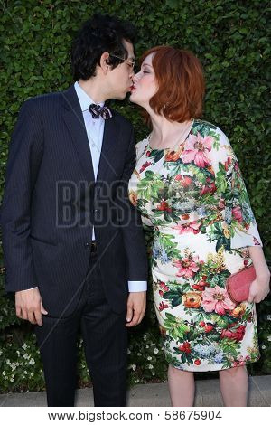 Geoffrey Arend and Christina Hendricks kissing at The Rape Foundation's Annual Brunch, Private Location, Beverly Hills, CA 09-29-13