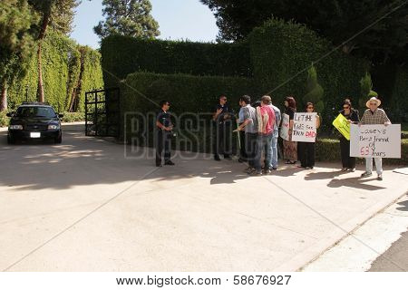 Police officers and protesters at Casey Kasem's house at a protest involving Casey Kasem's children, brother and friends who want to see him but have been denied any contact, Holmby Hills, CA 10-01-13